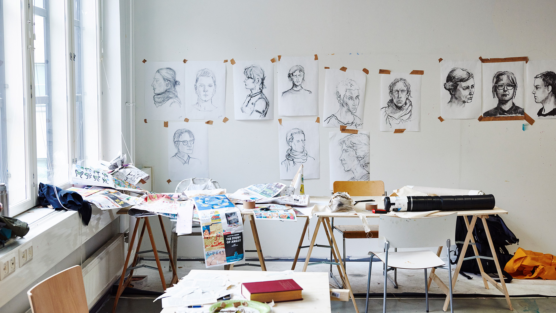 Drawings on a wall in a studio space
