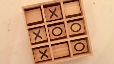 Wooden tic tac toe game from above.