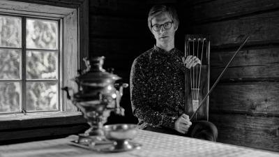 Ilkka Heinonen sits behind cottage table.