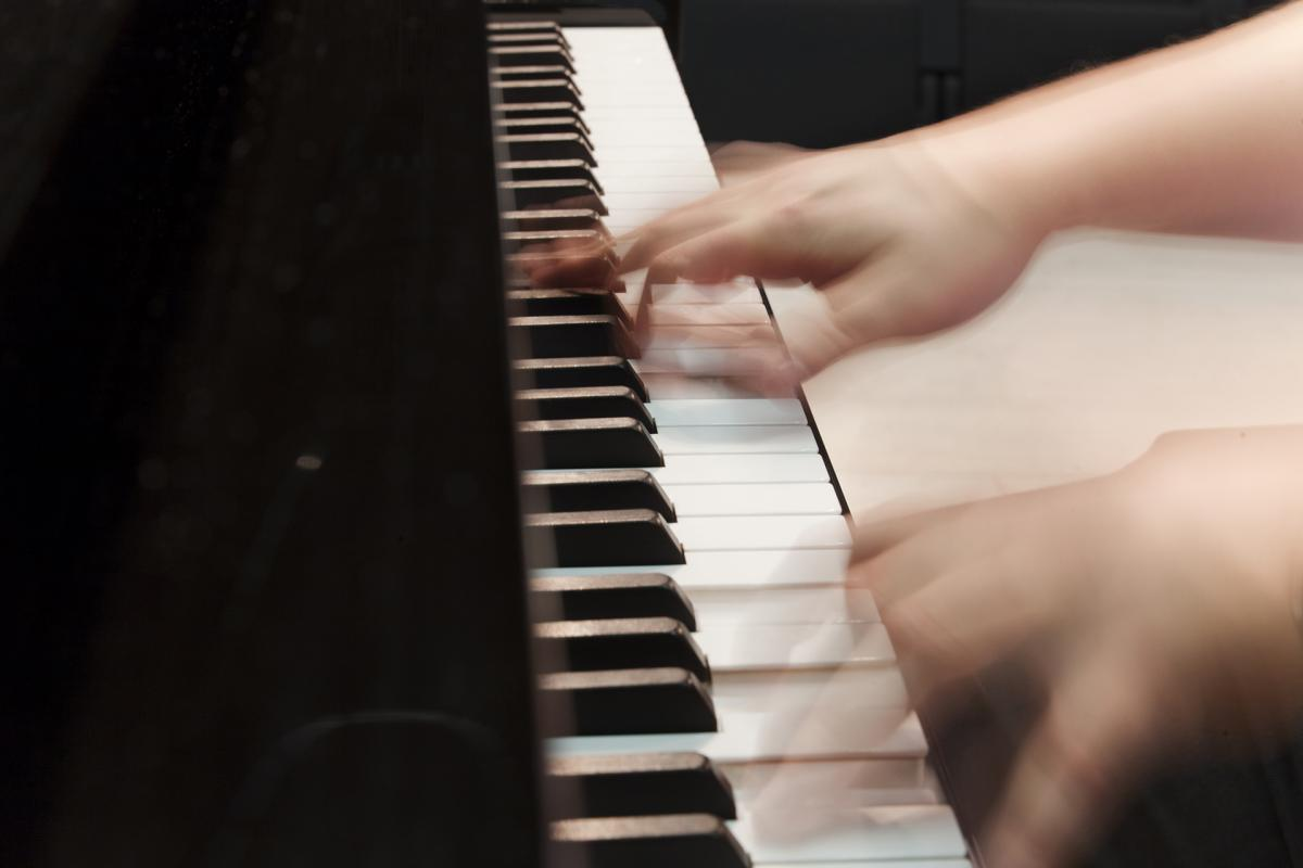 Fingers on piano keyboards