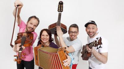 Freija is posing at studio with their instruments. Everyone is happy. Background of the photo is basic white.
