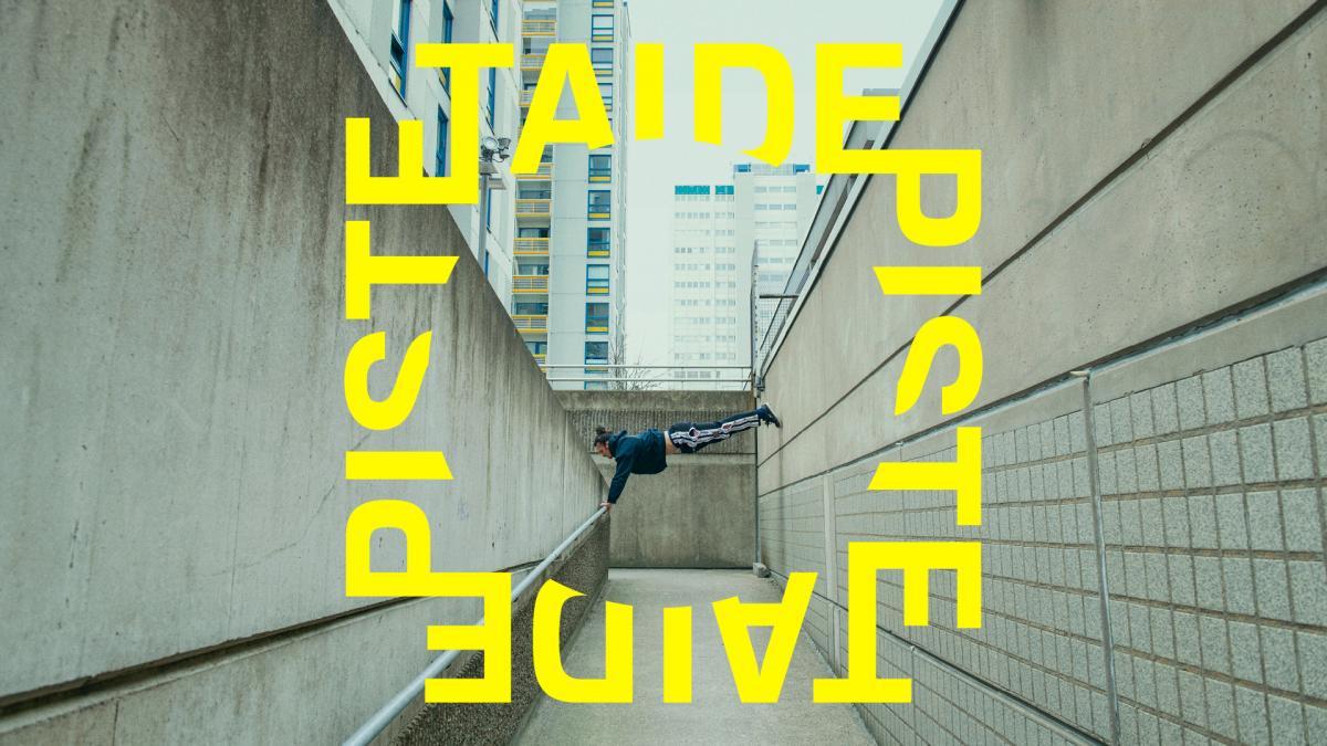 Nuori mies temppuilee betonilähiössä
