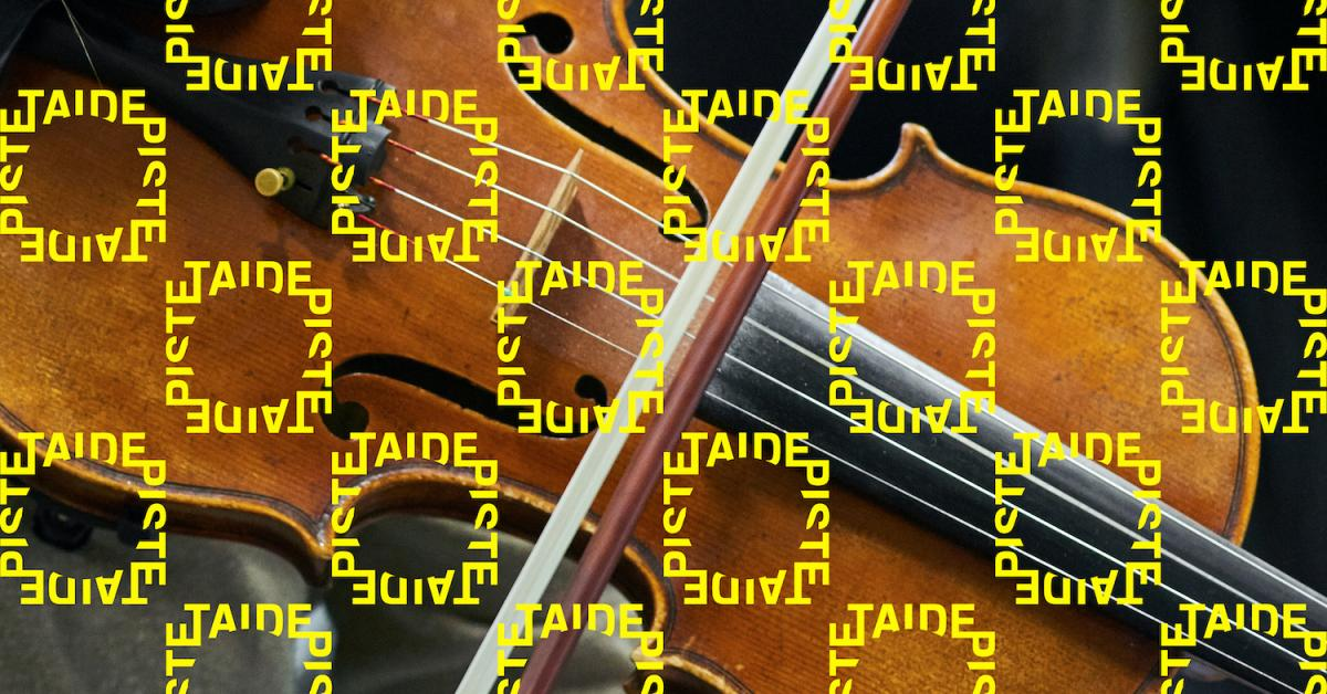 Photo of a violin with Taidepiste logos on it