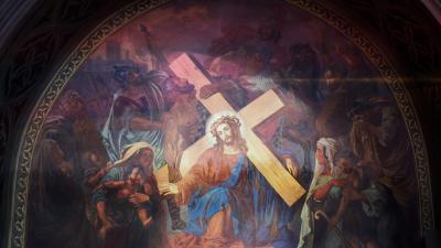 Kristillinen kuva. Kuvassa on Jeesus ristin kanssa. Maalaus.
