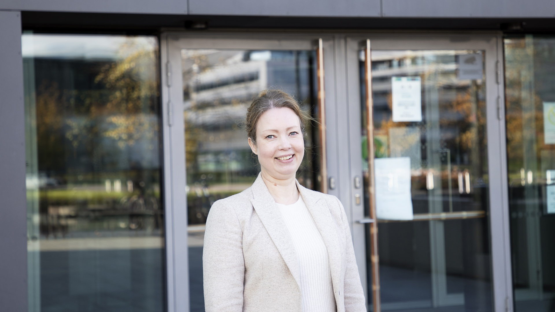Tanja Johansson stands outside of the Sibelius Academy's main entrance at Helsinki Music Centre